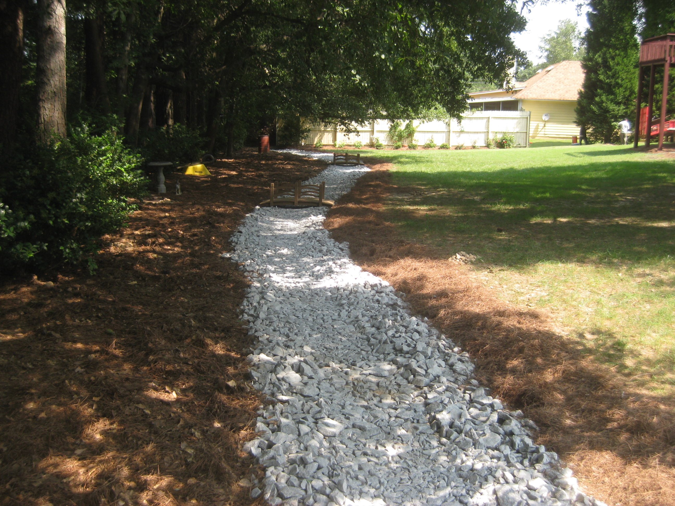 Water drainage solutions landscaping mcplants for Landscape drainage