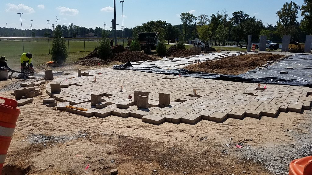 Cutting the curve for the Belgard Mega-Lafitt paver border at the Douglasville Military Honor Garden flag plaza