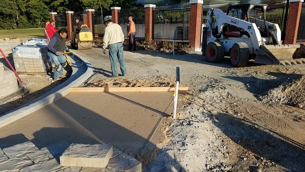 "Belgard Mega Laffit Pavers are install on 6""+ compacted aggregate with a 1"" sand base allong new parking lot curb. Douglasville Military Honor Garden."