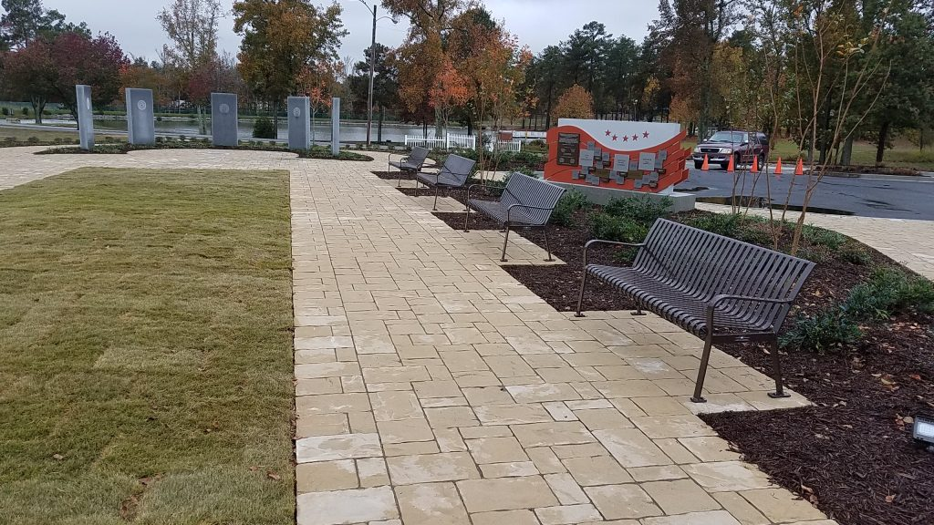 Southern ground level view of Douglasville's Military Honor Garden. Five Georgia Granite monuments stand will each representing a military branch.