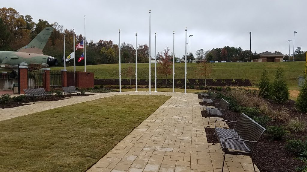 Northern ground level view of Douglasville's new Military Honor Garden. Six flag poles stand waiting for the United States flag and five military branch flags